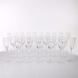 """Lenox Crystal Wine Glasses With 24K Gold Rims: A group of Lenox crystal wine glasses with 24K gold rims. There are twenty-four glasses in this lot with goblets and champagne flutes with 24 karat gold rims. The undersides are marked, """"Lenox/ Lenox USA."""""""