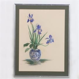 Ruth Van Z Hamilton Pastel on Paper of Irises: An original pastel on paper of irises by Ruth Van Z Hamilton. This still life piece depicts three purple irises with shapely petals rising alongside greenery completing the bouquet resting in a white vase with blue detail against a beige background. This piece is signed by the artist to the lower left corner. It is presented behind a green mat behind acrylic glass in a silver tone metal frame. Verso includes wire for hanging purposes.