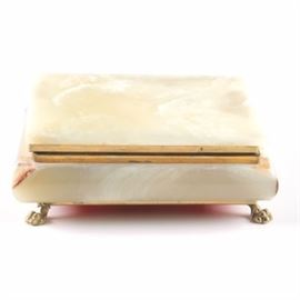 Agate Clawfoot Jewelry Box: An agate, clawfoot jewelry box. This hinged top box features a a misty white agate exterior with gold tone metal trim and a red interior. The box rises on four gold tone metal claw-shaped feet.