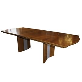 """ALF Italia Contemporary Dining Table: An ALF Italia contemporary style dining table. The rectangular shaped top has rounded ends, added leafs and rests on two curved legs with panels to the centers. The underside of the table is marked """"Made in Italy""""."""