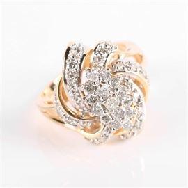 14K Diamond Cluster Swirl Ring: A 14K diamond cluster swirl ring.