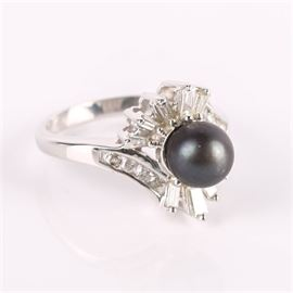 14K Gold Black Pearl Baguette and Round Diamond Bypass Ring: A 14K gold black pearl baguette and round diamond bypass ring.