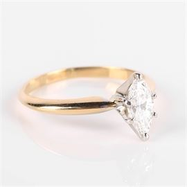 14K Gold Marquise Diamond Ring: A 14K gold marquise diamond ring.