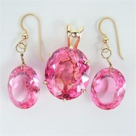 Pink Sapphire Earrings and Pendant in 14K Gold: A pair of synthetic pink sapphire pierced earrings and matching pendant.