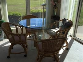 4 foot glass table with four rattan chairs