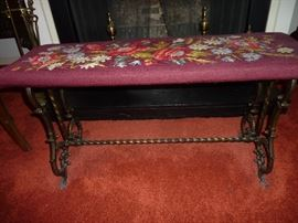 Iron bench with needlepoint cushion
