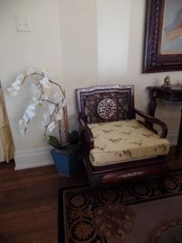 Carved rosewood armchairs