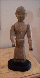 African figure on wood base
