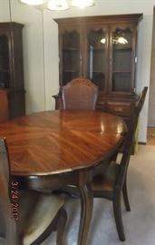 """Dining Room Table (61"""" x 42"""") w/4 chairs + two 18"""" leaves + custom made table pad. (Note: Hutch behind table has been sold)"""