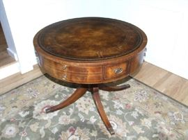 WEIMAN ANTIQUE DRUM TABLE, WITH DRAWERS AND EMBOSSED LEATHER TOP.