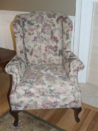 PAIR OF SOFT FLORAL DESIGN WING BACK CHAIRS FROM NORWALK FURNITURE COMPANY.