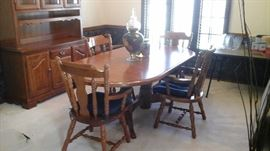 Wonderful dining room table with 6 chairs it has a matching buffet.