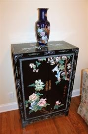 Asian lacquered cabinet and cobalt peacock vase