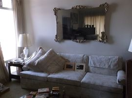 Sofa, end tables and large mirror.