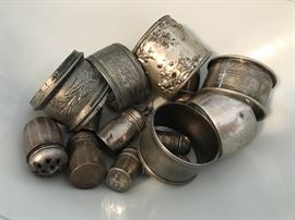Collection of sterling napkin rings and small salt & peppers