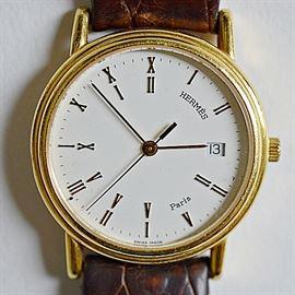 Hermes of Paris 18K Yellow Gold Men's Wristwatch: A Hermes of Paris 18K yellow gold quartz wristwatch.