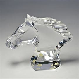 Baccarat Crystal Horse Head: A French Baccarat fine crystal small horse head figurine. The unbridled horse head has a flowing mane with an integrated faceted base. The figurine is marked to the verso with the acid-etched Baccarat logo.