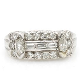 Platinum and Diamond Ring: A platinum and diamond ring. The total approximate group diamond weight is 0.86 ctw.