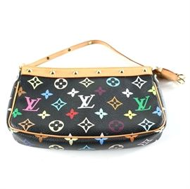 Louis Vuitton White Monogram Multicolore Accessories Pochette Bag: A Louis Vuitton White Monogram Multicolore Accessories Pochette Bag. This 2004 clutch features classic Louis Vuitton monogram print in a colorful variation against white coated canvas. The vachetta trim is accented by gold tone hardware including studs along the mouth and strap. The Louis Vuitton name is marked near the zipper. The date code, SD1014, is stamped into the interior lining. Made in the United States.