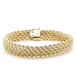18K Yellow Gold Rope Bracelet: An 18K yellow gold rope bracelet.