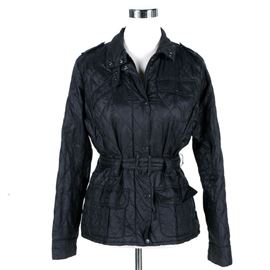 """Barbour Quilted Jacket: A quilted jacket by Barbour. This jacket is ornamented in a stitched lattice patterning throughout. Also included is a single chest pocket, two front pockets, and a belt along the waist and neck. The jacket closes with snap button closures down the front and along the wrists. A label on the interior is marked, """"Barbour, USA 10."""""""