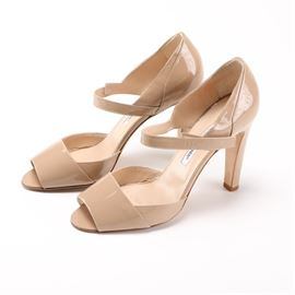 """Manolo Blahnik Pumps: A pair of Manolo Blahnik pumps. The pumps feature an open toe front with a velcro strap and are made of a patent leather. Shoes are size 40. The soles are marked """"Manolo Blahnik."""""""
