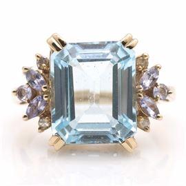 10K Yellow Gold Diamond, Blue Topaz, and Tanzanite Ring: A 10K yellow gold diamond, blue topaz, and tanzanite ring.