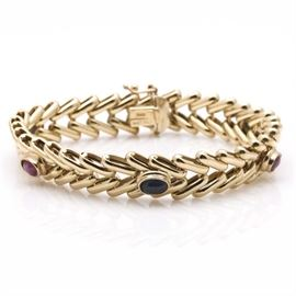 14K Yellow Gold Sapphire and Ruby Bracelet: A 14K yellow gold sapphire and ruby bracelet.