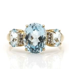 10K Yellow Gold Topaz and Diamond Ring: A 10K yellow gold topaz and diamond ring.