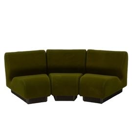 Don Chadwick Pie Slice Sofa for Herman Miller: A three-piece modular pie shaped sofa, upholstered in smooth form fitting fabric with black corrugated plastic bases. Sections can be used individually or together, manufactured by the Herman Miller furniture company.