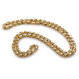 14K Yellow Gold Necklace: A 14K yellow gold necklace. This item features a box tab closure with a figure eight safety clasp that leads to a decorative Bismark style chain.