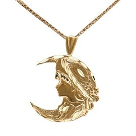 14K Yellow Gold Crescent Moon and Woman Pendant Necklace: A 14K yellow gold necklace. This necklace features a pendant with a crescent moon pendant and a woman's profile in an Art Nouveau style. The pendant has a satin finish with high polish accents, and attaches to a flat link curb chain.