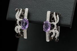 0.94 CTW Amethyst, Diamond, and 14K Two-Tone Gold Earrings: A pair of 0.94 ctw amethyst, diamond, and 14K two-tone gold earrings.