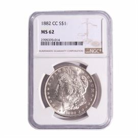 1882-CC Morgan Silver Dollar NGC Graded M62: An encapsulated 1882-CC Morgan silver dollar, graded MS 62 by NGC. Designer: George T. Morgan . Mintage: 1,133,000. Metal Content: 90% silver, 10% copper. Diameter: 38.1 mm. Weight 26.73 grams. Good condition.