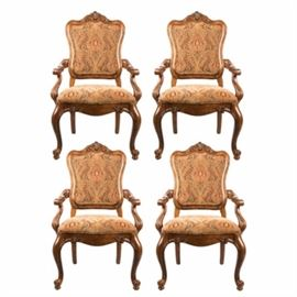 "Ethan Allen ""Tuscany Augustine"" Dining Chairs: A set of four ""Tuscany Augustine"" arm chairs by Ethan Allen. These Italian inspired dining chairs have serpentine backs with a carved crest, gently curved arms, serpentine aprons, and cabriole legs with scrolled feet to the front. The chairs have a heavy tapestry upholstery in a palette of rich earth tones."