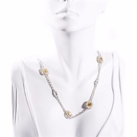 Judith Ripka Sterling Silver White Sapphire and Yellow Crystal Necklace: A sterling silver 8-station necklace with white sapphires and yellow crystals by Judith Ripka.