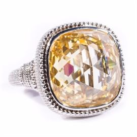 Judith Ripka Sterling Silver and Yellow Crystal Cocktail Ring: An ornate sterling silver and yellow faceted crystal cocktail ring by Judith Ripka.