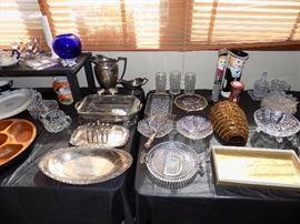 Silver plate serving pieces. Cut glass. Decorative items