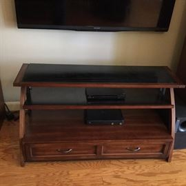 Tv stand with wood and tempured smoke glass