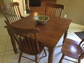 Keller solid table, four chairs, one extra leaf