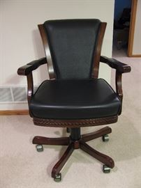 One of six chairs that were bought with the game table.  The chair has multiple adjusts available.