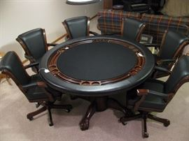 Game table top will flip flop to a smooth surface from poker top with glass holders.