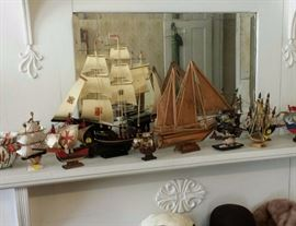 Collection of miniature ships and hats, including mink hats
