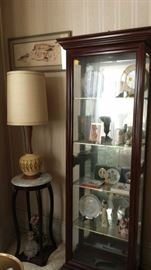 Mid Century lamp and display cabinet that contains White House collectible Christmas Ornaments and other smalls