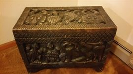 Handcarved wooden trunk