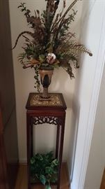 plant stand and floral arrangement
