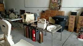 Vintage fire extinguishers and boxes full of books and magazines