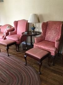 Wingback chairs and ottomans and side table