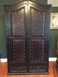 Armoire - Wood with leather faces with nailhead trim. 84 inches tall, 48 inches wide, 29 inches deep.
