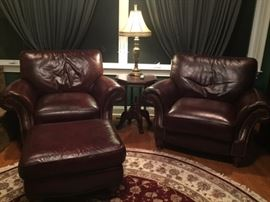 2 plush leather chairs.  Leather in excellent condition.  Includes Ottoman and Leather Conditioning Kit.